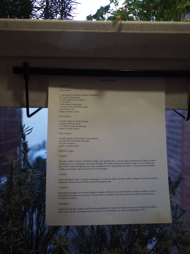 Picture of the printed recipe attached to a box with herbs over a flower pot with lavender