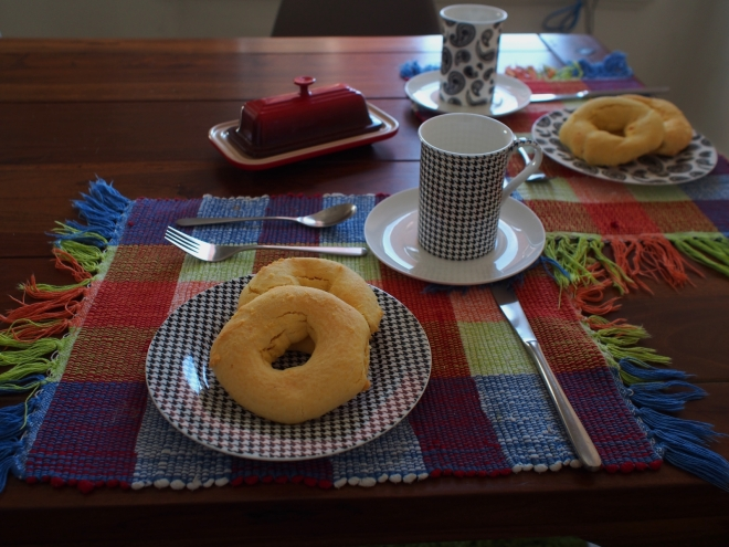 A table is set for two people. In each of the plates there lies two chipas.